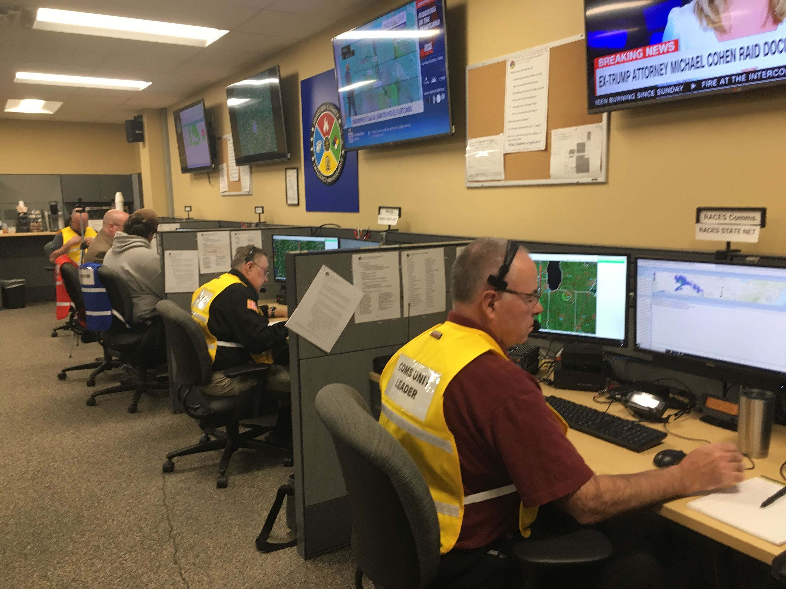 Trained personnel staffing positions in the Emergency Operations Center during a tornado watch